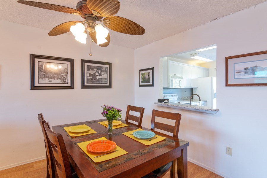 Real Estate Photography - 10441 Waterbird Way, Bradenton, FL, 34209 - Dining Area