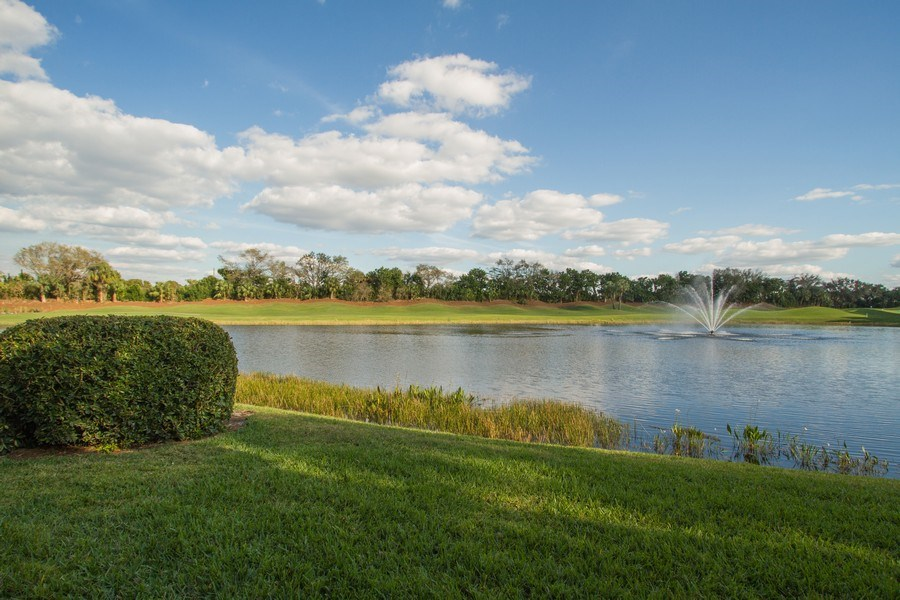 Real Estate Photography - 2280 Carrington Ct #101, Naples, FL, 34109 - Lake