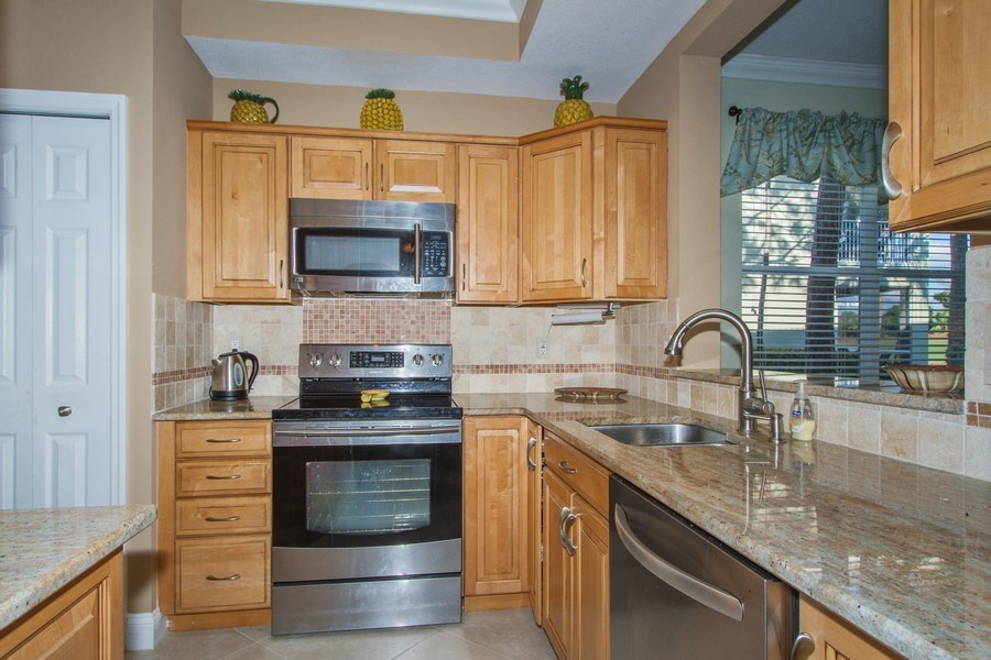 Real Estate Photography - 2280 Carrington Ct #101, Naples, FL, 34109 - Kitchen