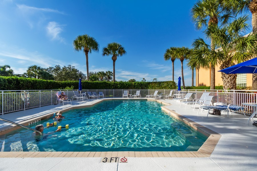 Real Estate Photography - 2285 Harmony Ln, Unit 203, Naples, FL, 34109 - Pool