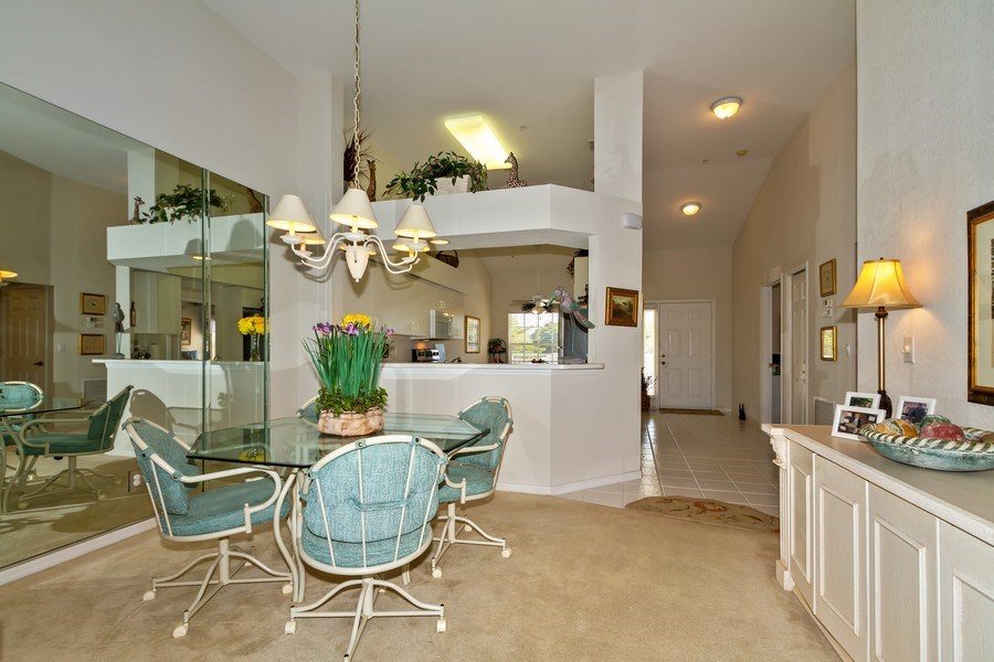 Real Estate Photography - 2285 Harmony Ln, Unit 203, Naples, FL, 34109 - Dining Room