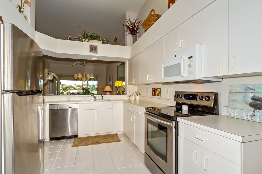 Real Estate Photography - 2285 Harmony Ln, Unit 203, Naples, FL, 34109 - Kitchen