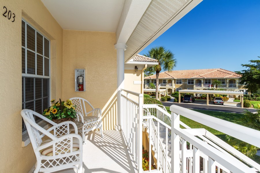 Real Estate Photography - 2285 Harmony Ln, Unit 203, Naples, FL, 34109 - Porch
