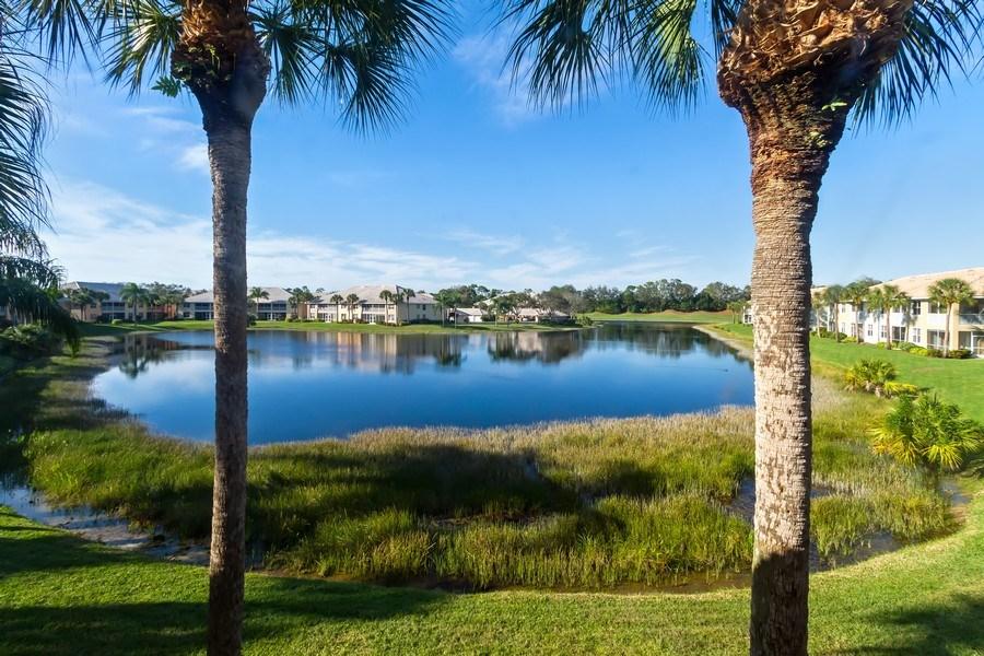 Real Estate Photography - 2285 Harmony Ln, Unit 203, Naples, FL, 34109 - Lake View