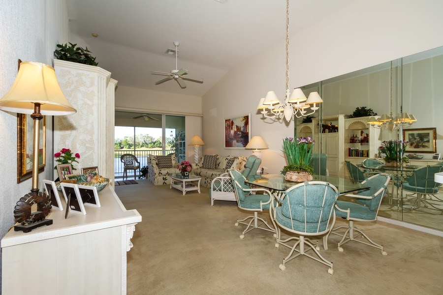 Real Estate Photography - 2285 Harmony Ln, Unit 203, Naples, FL, 34109 - Living Room / Dining Room