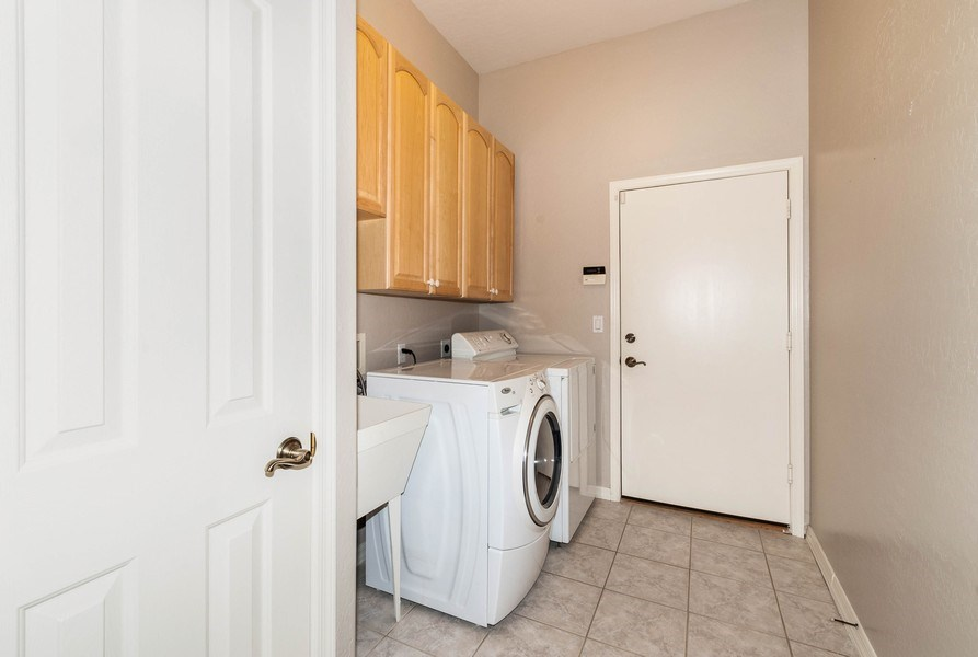 Real Estate Photography - 17685 W Eagle Dr, Goodyear, AZ, 85338 - Laundry Room