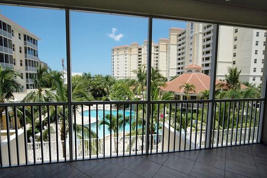 Real Estate Photography - 460 Launch Cir, Unit 302, Naples, FL, 34108 - Lanai