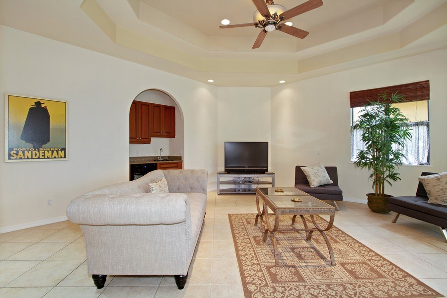 Real Estate Photography - 10691 LONGSHORE WAY EAST, NAPLES, FL, 34119 - Living Room with Wet Bar & Wine Cooler