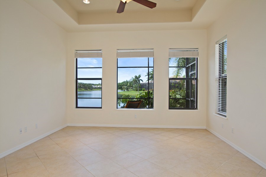 Real Estate Photography - 10691 LONGSHORE WAY EAST, NAPLES, FL, 34119 - Master Bedroom with Amazing Lake View