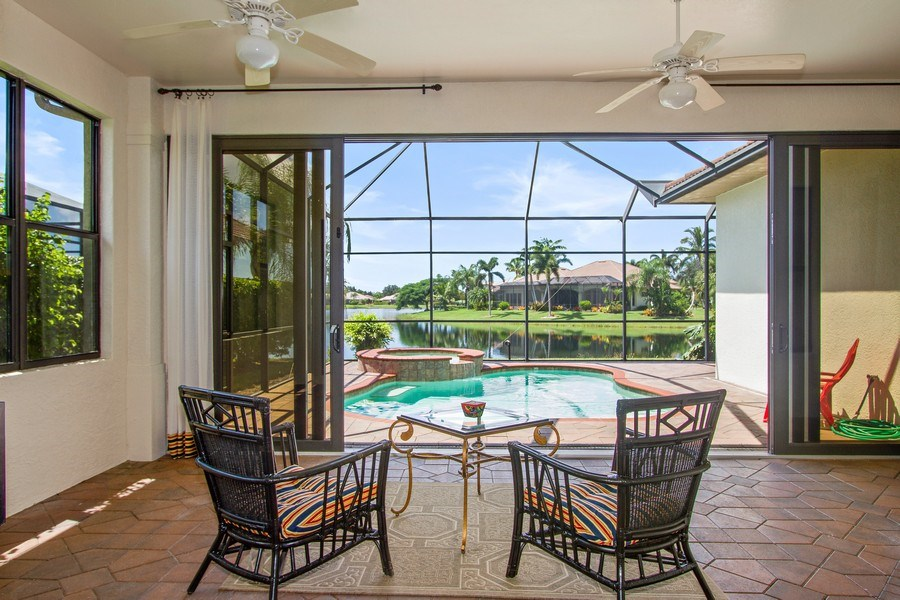 Real Estate Photography - 10691 LONGSHORE WAY EAST, NAPLES, FL, 34119 - Florida Rm: Indoor or Outdoor Space using Glass Sl