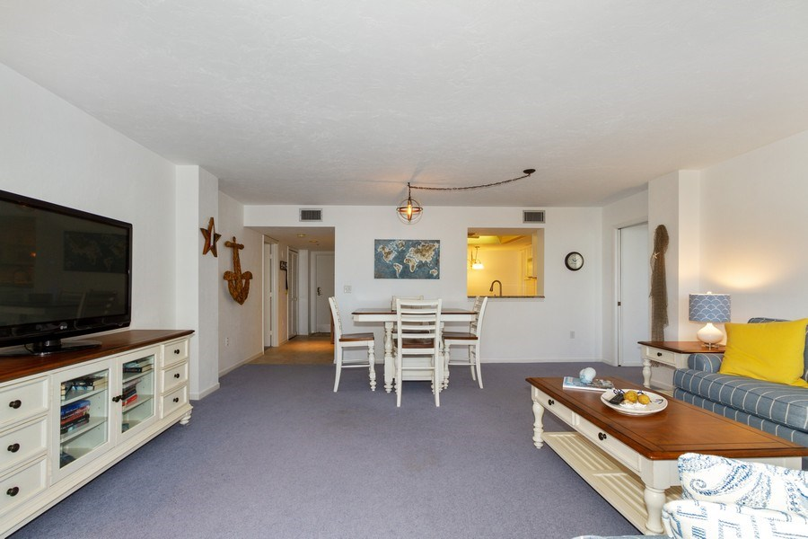 Real Estate Photography - 11030 Gulf Shore Dr, Unit 404, Naples, FL, 34108 - Living Room