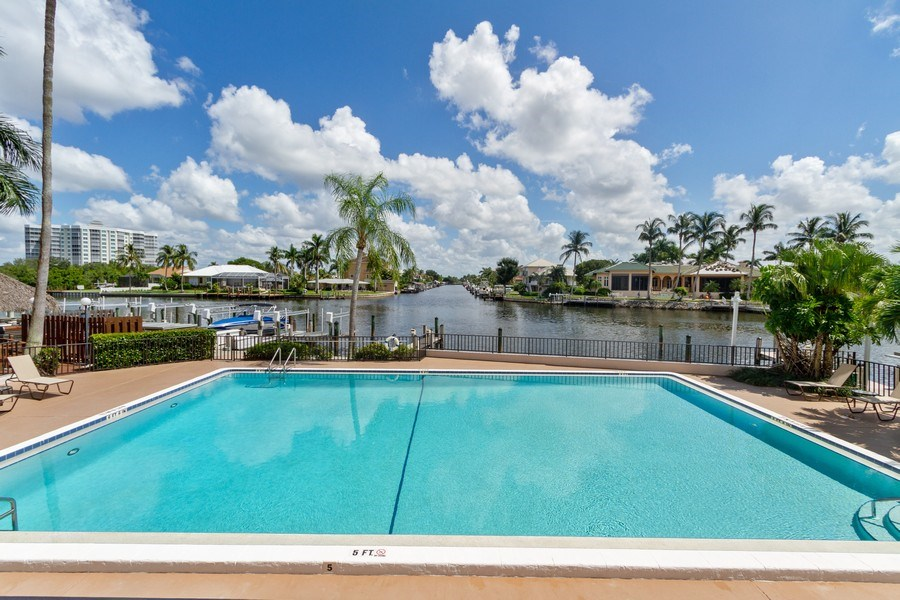 Real Estate Photography - 11030 Gulf Shore Dr, Unit 404, Naples, FL, 34108 - Outdoor Pool