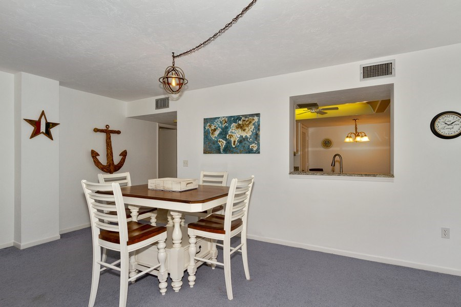 Real Estate Photography - 11030 Gulf Shore Dr, Unit 404, Naples, FL, 34108 - Dining Room