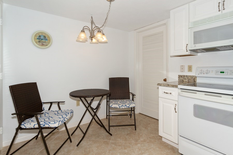 Real Estate Photography - 11030 Gulf Shore Dr, Unit 404, Naples, FL, 34108 - Breakfast Nook