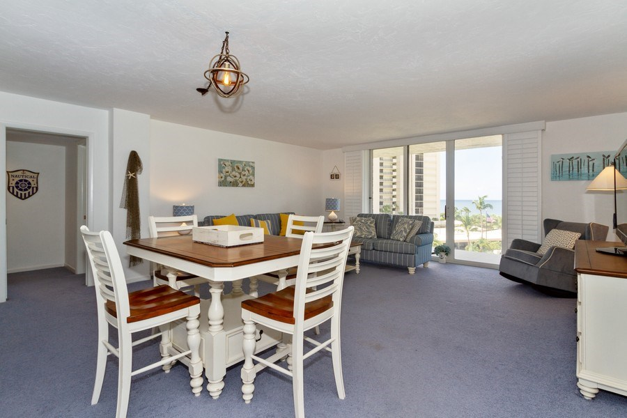 Real Estate Photography - 11030 Gulf Shore Dr, Unit 404, Naples, FL, 34108 - Living Room / Dining Room