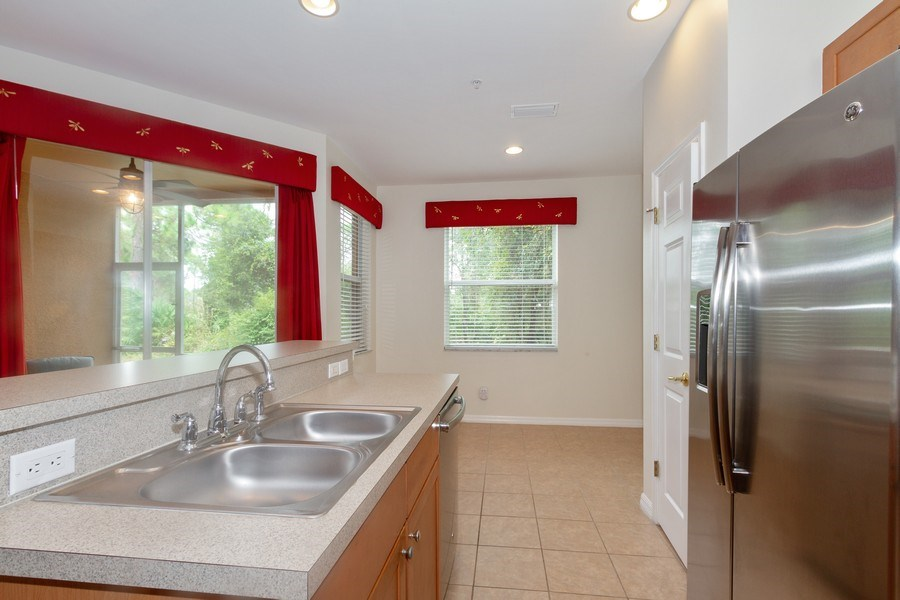 Real Estate Photography - 28105 Mandolin Ct, Unit 213, Bonita Springs, FL, 34135 - Kitchen