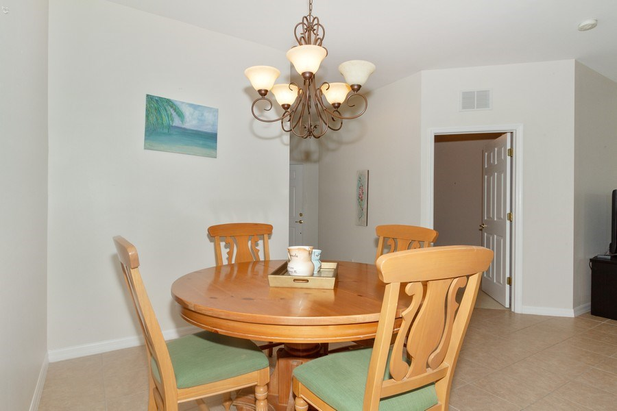 Real Estate Photography - 28105 Mandolin Ct, Unit 213, Bonita Springs, FL, 34135 - Dining Room