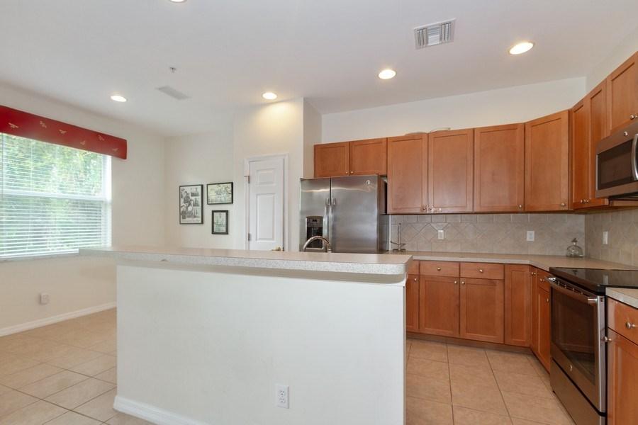 Real Estate Photography - 28105 Mandolin Ct, Unit 213, Bonita Springs, FL, 34135 - Kitchen