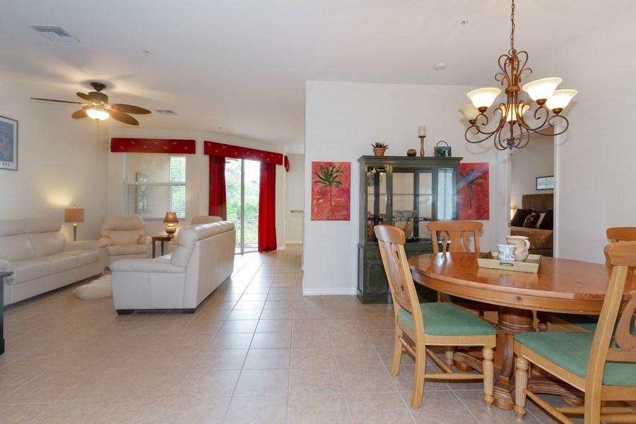 Real Estate Photography - 28105 Mandolin Ct, Unit 213, Bonita Springs, FL, 34135 - Living Room / Dining Room