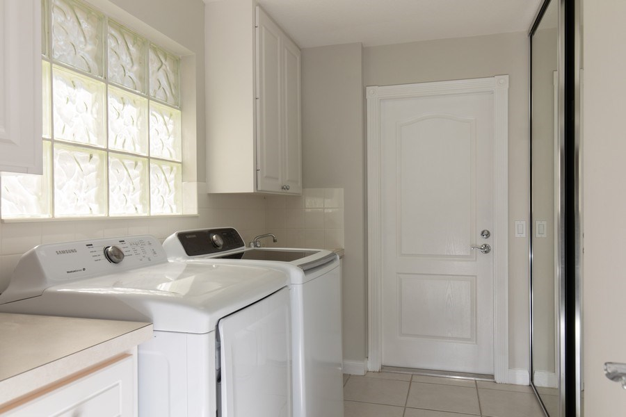 Real Estate Photography - 3612 Exuma Way, Naples, FL, 34119 - Laundry Room