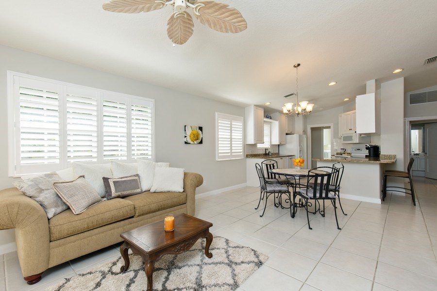 Real Estate Photography - 3612 Exuma Way, Naples, FL, 34119 - Living Room / Dining Room