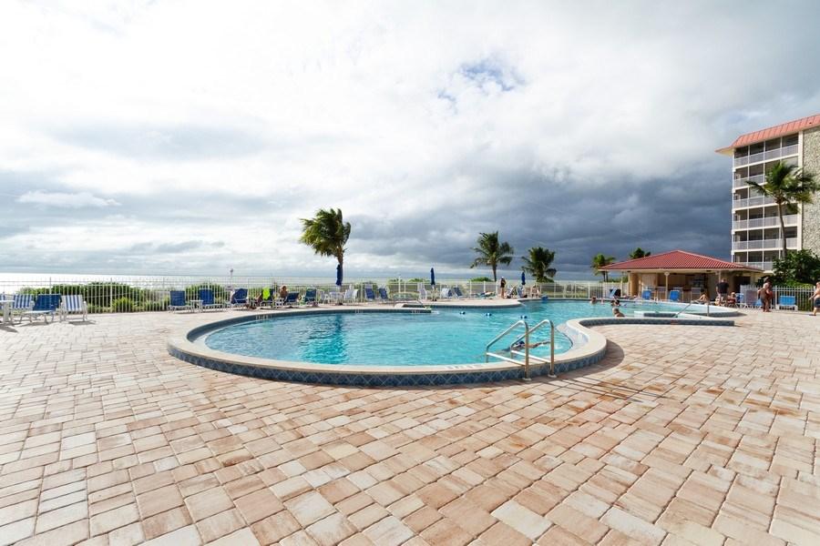 Real Estate Photography - 25740 Hickory Blvd, #D250, Bonita Springs, FL, 34134 - Outdoor Pool