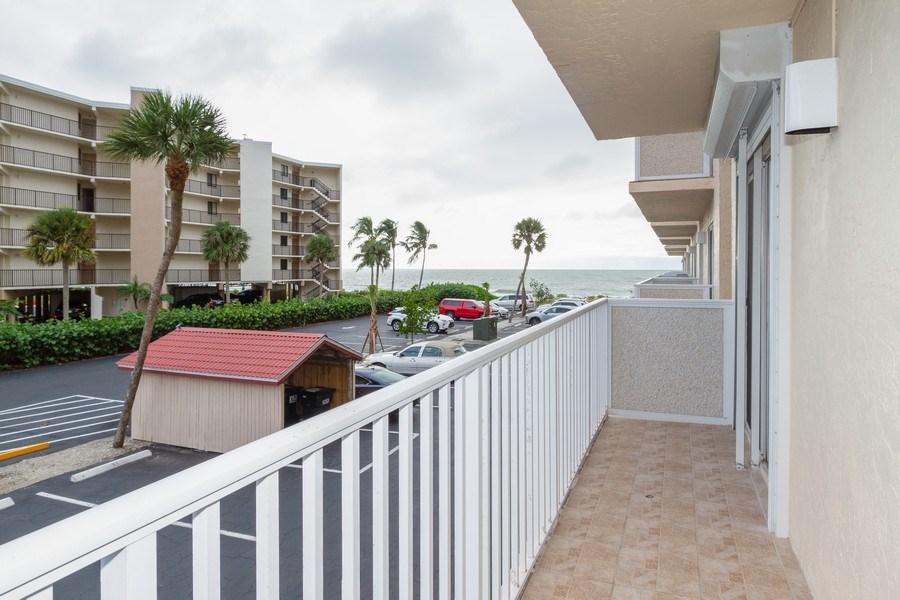 Real Estate Photography - 25740 Hickory Blvd, #D250, Bonita Springs, FL, 34134 - Balcony