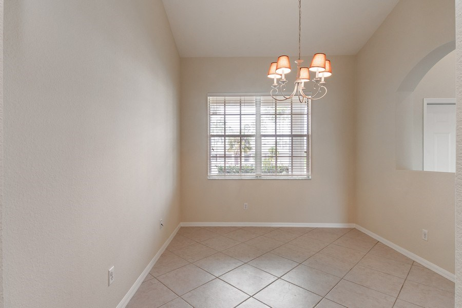 Real Estate Photography - 10650 LANDAU LN, Bonita Springs, FL, 34135 - Dining Room
