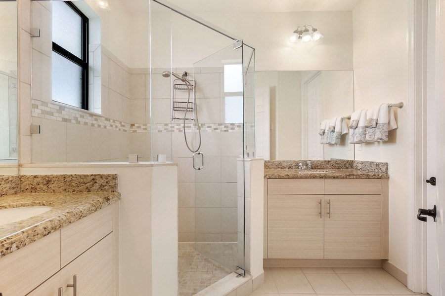 Real Estate Photography - 5455 Ferris Ave, Ave Maria, FL, 34142 - Master Bath dual vanities  Spacious Shower