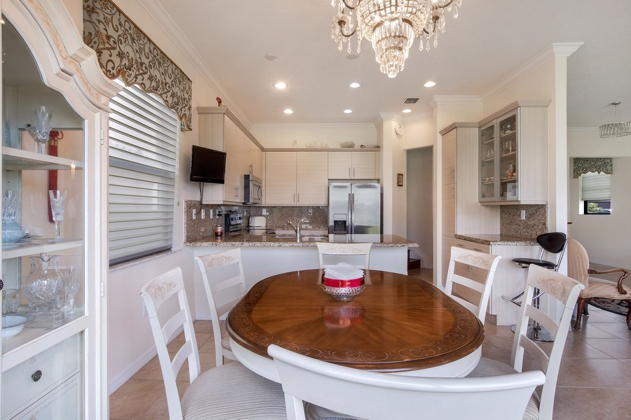 Real Estate Photography - 5455 Ferris Ave, Ave Maria, FL, 34142 - breakfast area