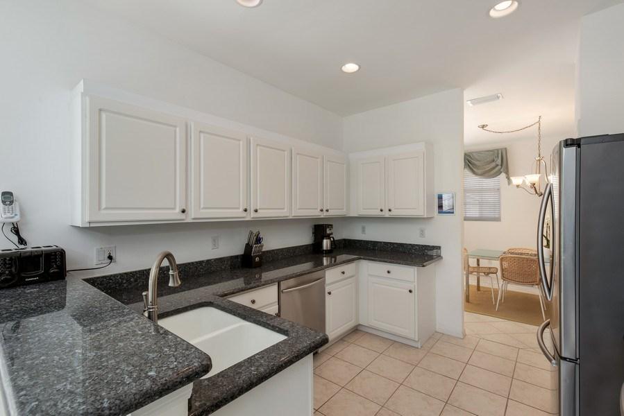 Real Estate Photography - 25071 BALLYCASTLE CT #203, Bonita Springs, FL, 34134 - Kitchen