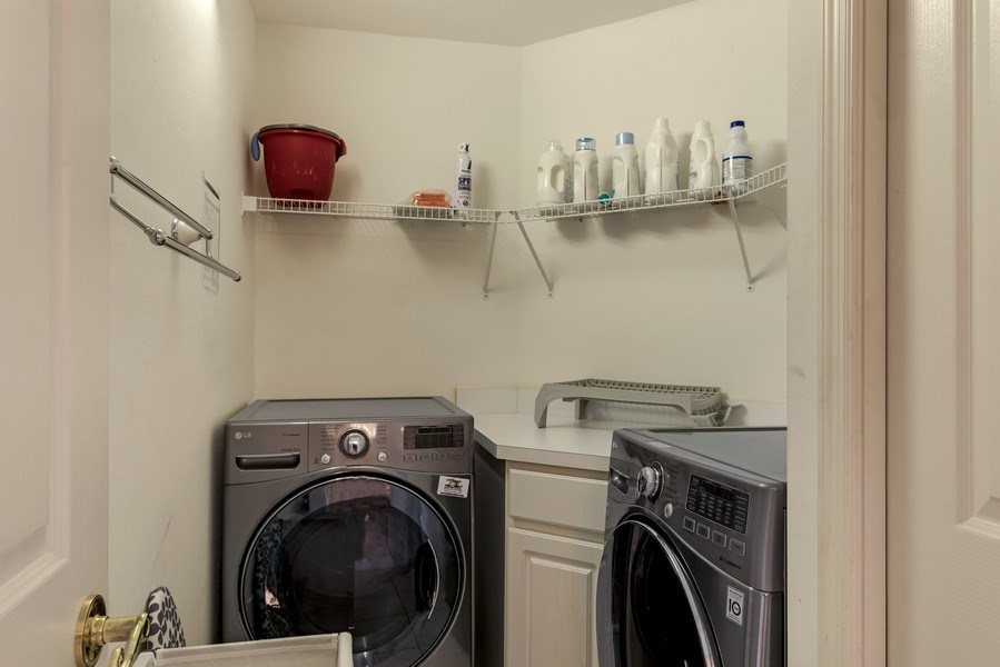 Real Estate Photography - 25071 BALLYCASTLE CT #203, Bonita Springs, FL, 34134 - Laundry Room