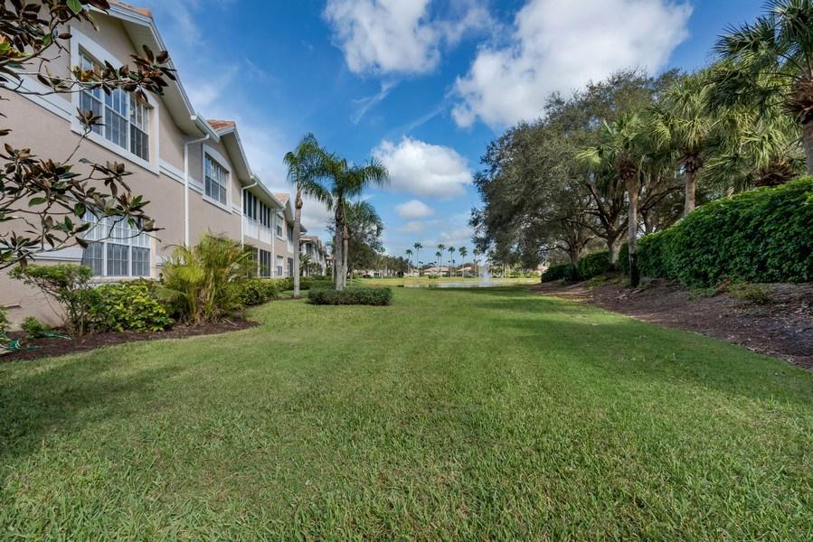 Real Estate Photography - 25071 BALLYCASTLE CT #203, Bonita Springs, FL, 34134 - Rear View