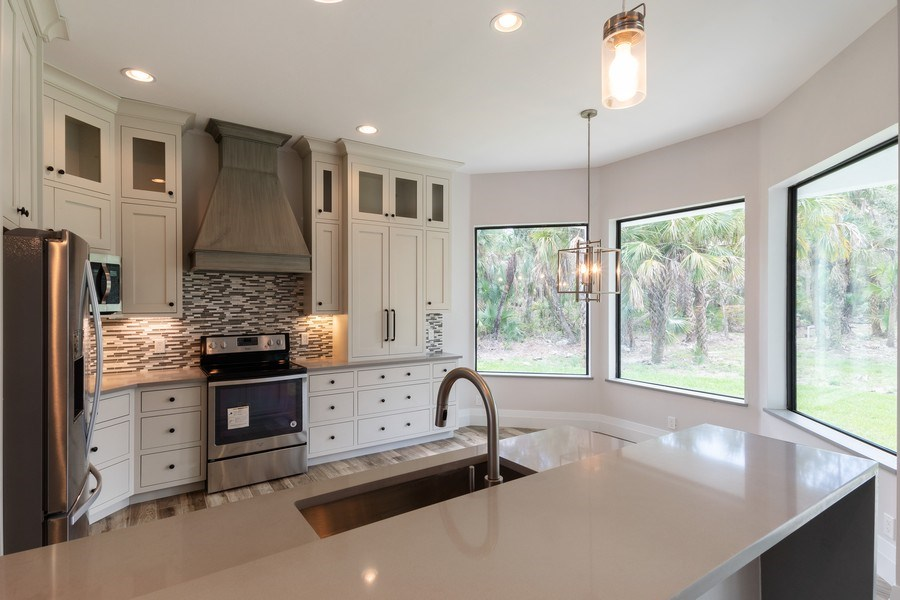 Real Estate Photography - 1160 14th Ave NE, Naples, FL, 34120 - Kitchen