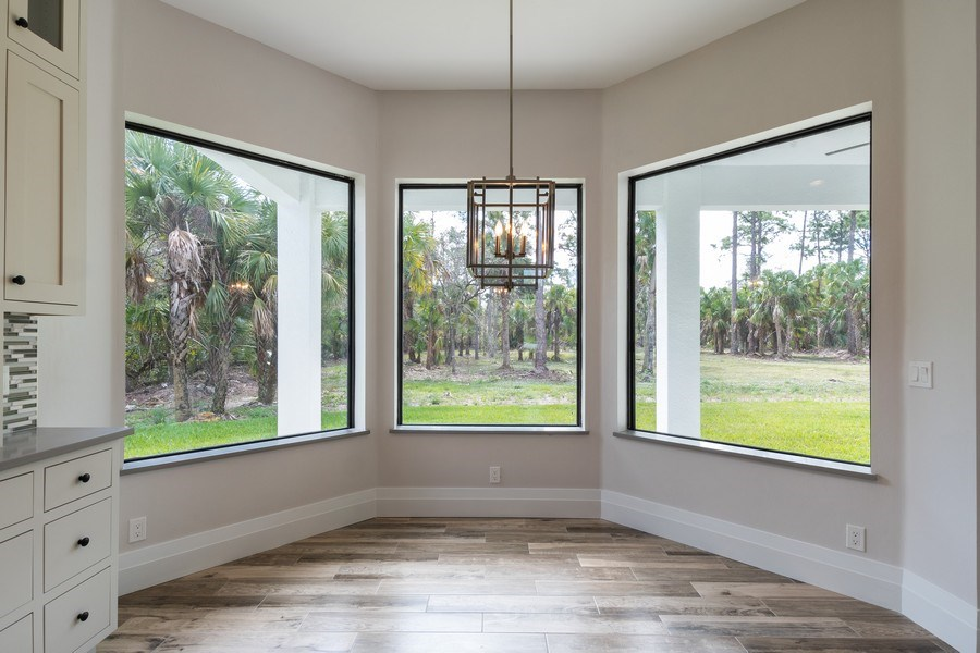 Real Estate Photography - 1160 14th Ave NE, Naples, FL, 34120 - Dining Area