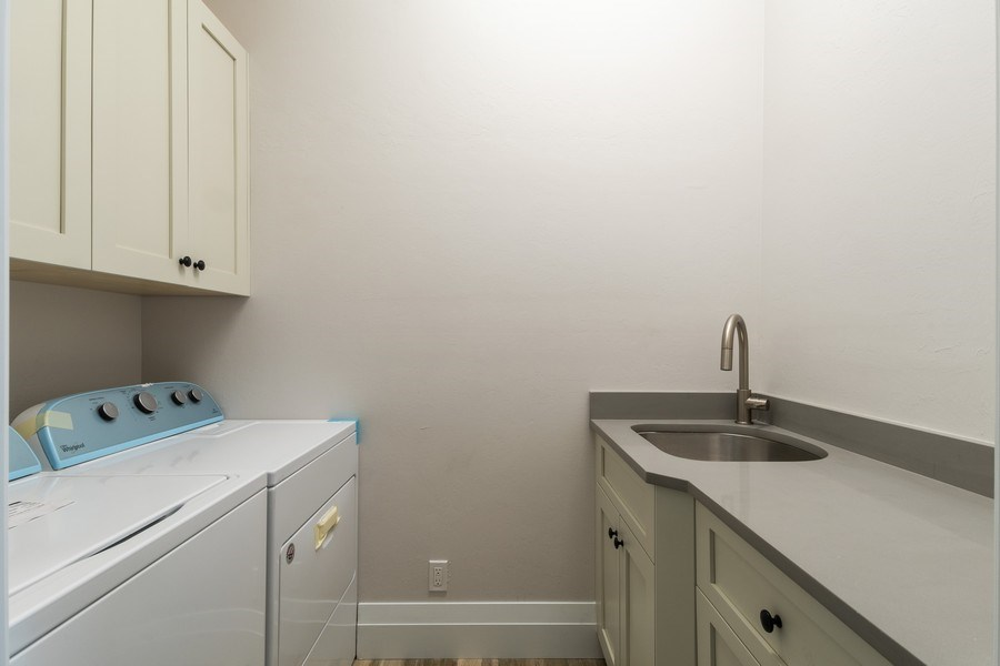 Real Estate Photography - 1160 14th Ave NE, Naples, FL, 34120 - Laundry Room