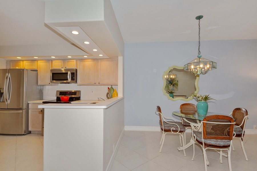 Real Estate Photography - 13060 Amberley Ct, Unit 804, Bonita Springs, FL, 34135 - Kitchen / Dining Room