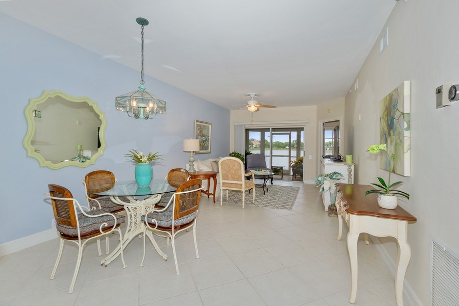 Real Estate Photography - 13060 Amberley Ct, Unit 804, Bonita Springs, FL, 34135 - Living Room / Dining Room