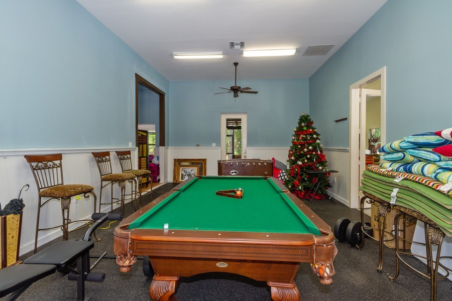 Real Estate Photography - 4381 3rd Ave Northwest, Naples, FL, 34119 - Guest House Family Room