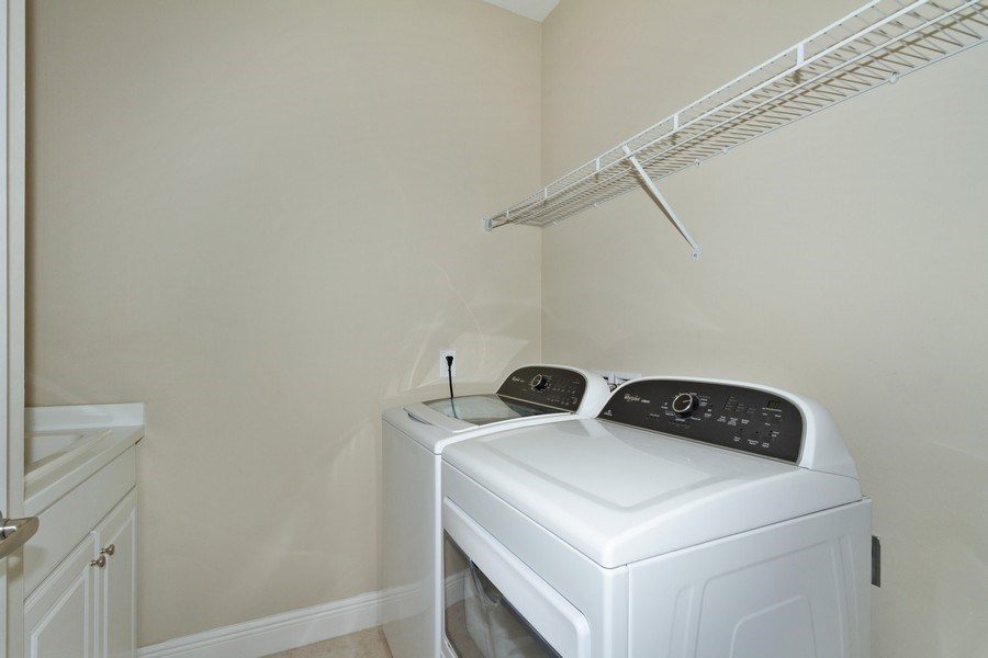 Real Estate Photography - 3735 Canopy Cir, Naples, FL, 34120 - Laundry Room