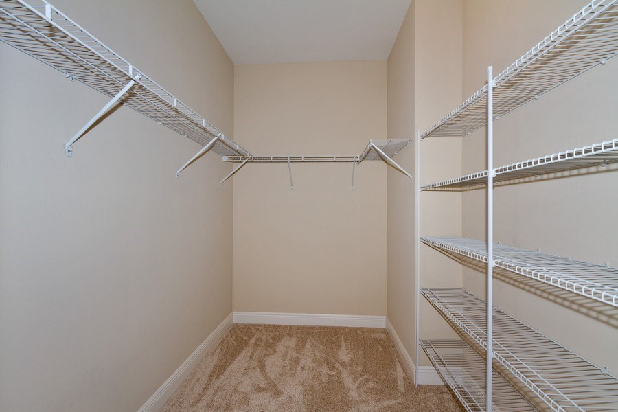 Real Estate Photography - 3735 Canopy Cir, Naples, FL, 34120 - Master Bedroom Closet