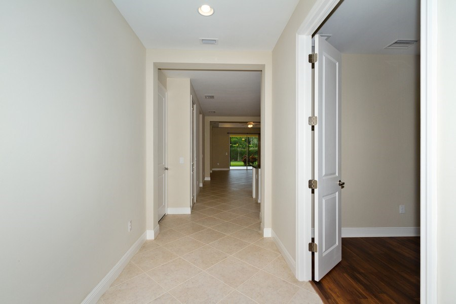 Real Estate Photography - 3735 Canopy Cir, Naples, FL, 34120 - Hallway