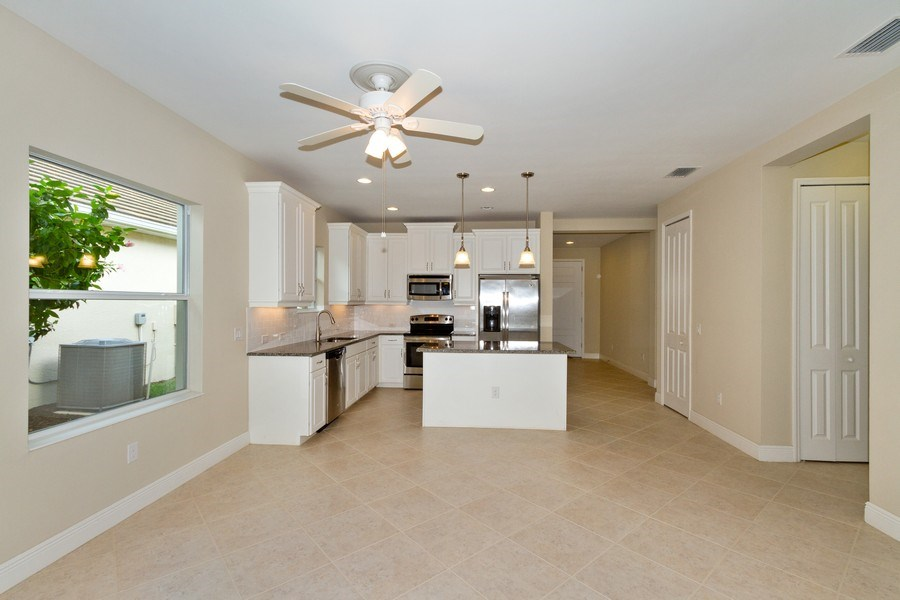 Real Estate Photography - 3735 Canopy Cir, Naples, FL, 34120 - Living Room/Dining Room