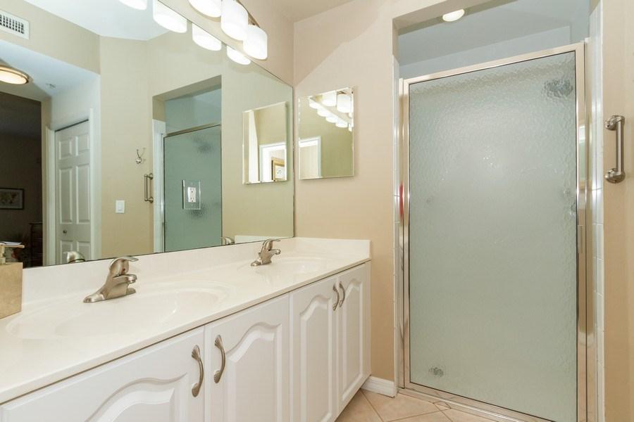 Real Estate Photography - 2345 Carrington Ct #102, Naples, FL, 34109 - Master Bathroom