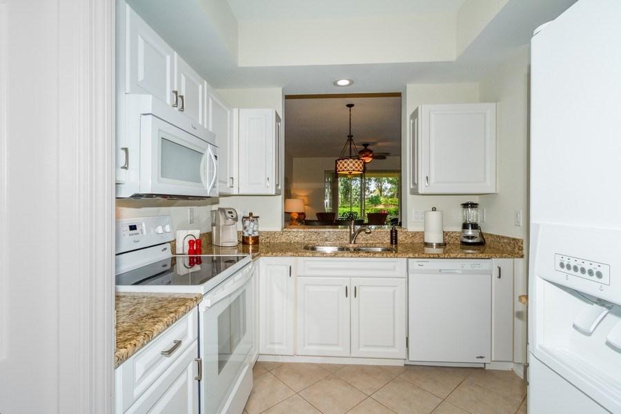 Real Estate Photography - 2345 Carrington Ct #102, Naples, FL, 34109 - Kitchen