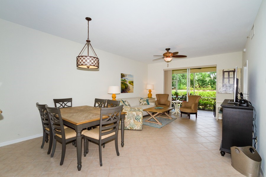 Real Estate Photography - 2345 Carrington Ct #102, Naples, FL, 34109 - Living Room / Dining Room