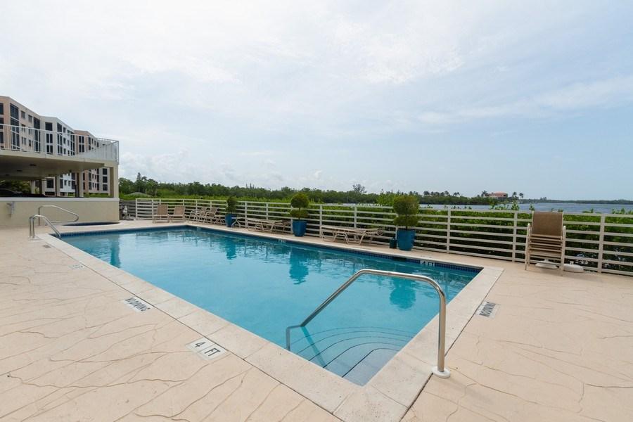 Real Estate Photography - 4895 Bonita Beach Rd, 504, Bonita Springs, FL, 34134 - Outdoor Pool