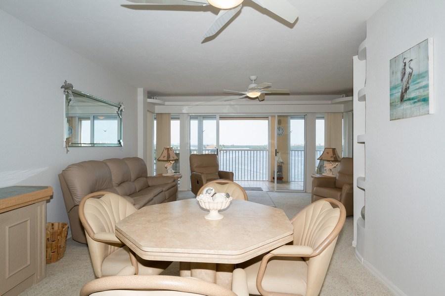 Real Estate Photography - 4895 Bonita Beach Rd, 504, Bonita Springs, FL, 34134 - Living Room / Dining Room