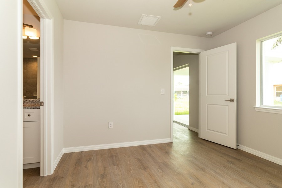 Real Estate Photography - 815 Vogiantzis Parkway, Cape Coral, FL, 33909 - 2nd Bedroom