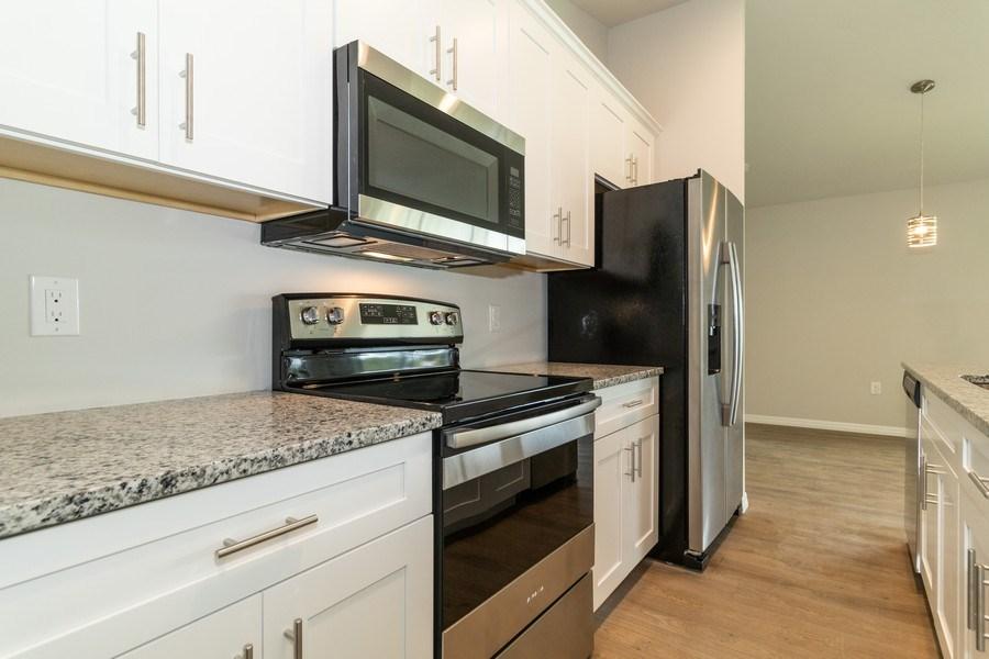 Real Estate Photography - 815 Vogiantzis Parkway, Cape Coral, FL, 33909 - Kitchen